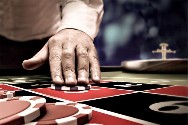 Dealer sliding chip across table